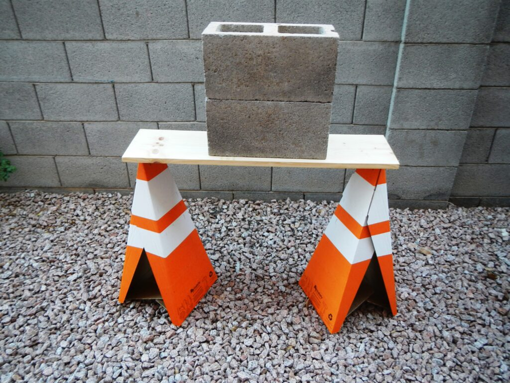Sturdy & Strong, Safety Cones Supporting Concrete Blocks