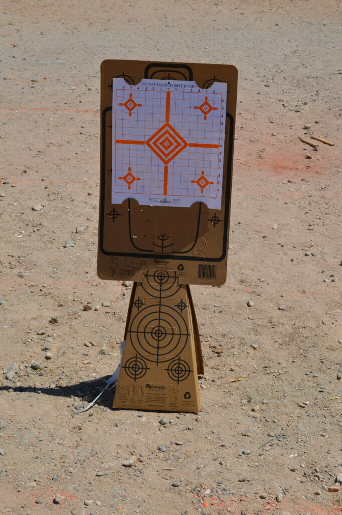 Target Cones & Silhouette Targets Holding 100-yard Rifle Paper Target at the Shooting Range